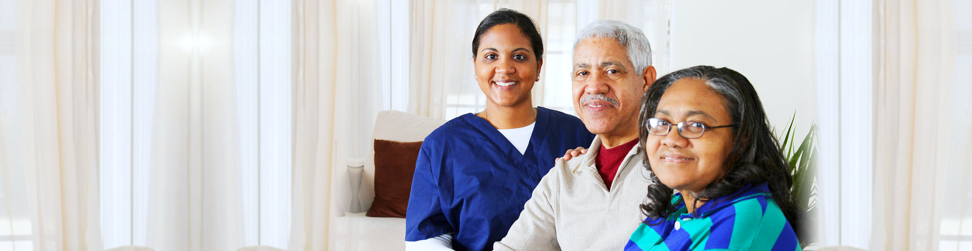 caregiver and her elderly couple patient